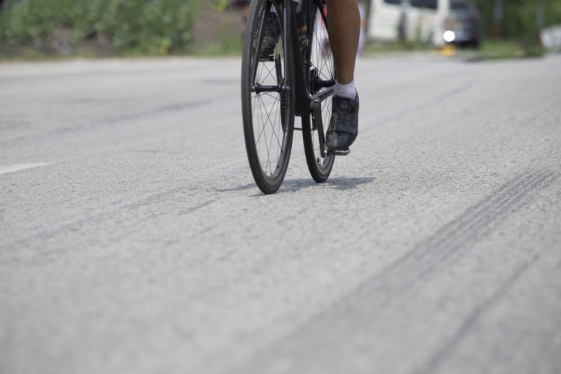 Cycling competition,rides a bike on asphalt road.