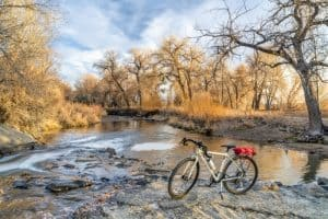 touring bike and a river in fall scenery